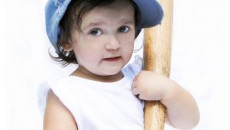 Little-girl-ready-to-play-baseball-isolated-on-a-white-background-Uploaded-byZoofy-TheJi-sxc-hu